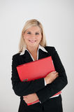 Young busines woman in a suit  with folder Royalty Free Stock Image
