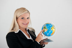 Young busines woman in a suit with globe. In her hand. gray background stock photos