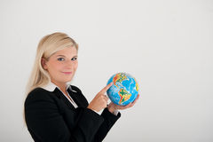 Young busines woman in a suit with globe Stock Images