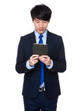 Young business asian man using his tablet Stock Photos