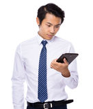 Young business asian man using his tablet Stock Image