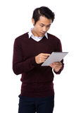 Young business asian man using his tablet Royalty Free Stock Image