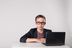Young business boy working at the laptop Royalty Free Stock Images