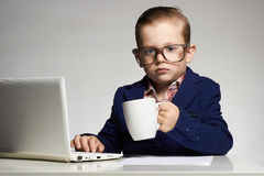 Young business child with computer stock photo