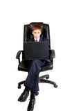 Young business child using laptop. Young business boy using laptop Stock Image