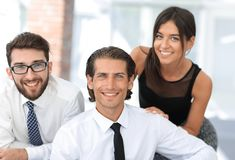 Young business colleagues in the background of the office Stock Images