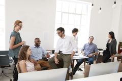 Young business colleagues at casual meeting in their office stock photography