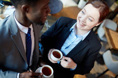 Young Business Colleagues Chatting Over Coffee royalty free stock photography
