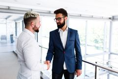 Young Business Colleagues Congrats Eachother. Young Business Colleagues Congrats Each other - hand skahe, shaking hands stock photo