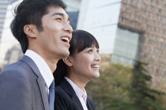 Young Business Colleagues Looking Away and Laughing Stock Photo