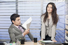 Young business colleagues working together. In the office Royalty Free Stock Photography
