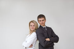 Young business couple. Standing on white background Stock Photos