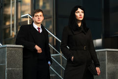 Young business couple against office building Stock Photos