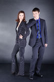 Young Business Couple on a black background Stock Photo