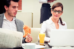 Young Business Couple In A Cafe Stock Image