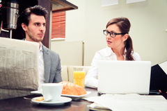 Young Business Couple In A Cafe Royalty Free Stock Photography