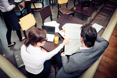 Young Business Couple In A Cafe Stock Photography