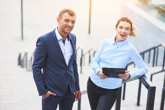 Young business couple with clipboard. Stock Images