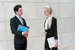 Young business couple with file and laptop. Stock Photo