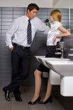 Young business couple flirting Stock Photography