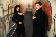 Young fashion business couple in a subway tunnel Stock Photo