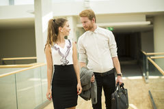 Young business couple in the hallway Stock Photo