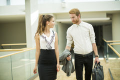 Young business couple in the hallway Royalty Free Stock Photography