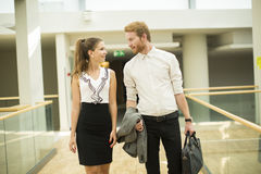 Young business couple in the hallway Stock Photos