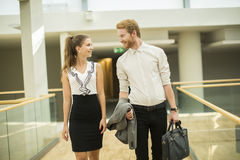 Young business couple in the hallway Stock Image
