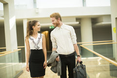 Young business couple in the hallway Royalty Free Stock Photo