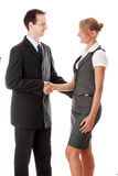 Young business couple handshaking. Isolated on white Stock Images