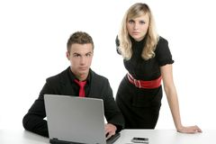 Young business couple laptop isolated on white Royalty Free Stock Photography