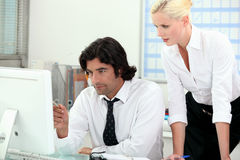 Young business couple. In an office Stock Images