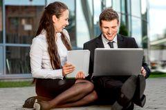 Young Business couple outdoors. Royalty Free Stock Photography