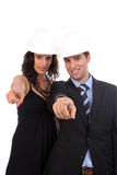 Young Business Couple pointing forward Stock Images