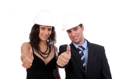 Young Business Couple showing thumbs up. Isolated on white Royalty Free Stock Images