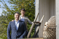 Young business couple. In smart casual clothes outdoors on the sunny autumn day, shot with rustic background Stock Images