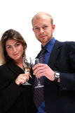 Young business couple - success. Image of two young business people toasting success royalty free stock photo