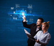 Young business couple touching future web technology buttons and Royalty Free Stock Photography