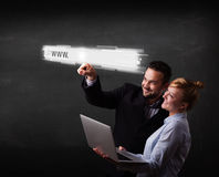 Young business couple touching web browser address bar with www Royalty Free Stock Photos