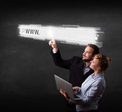 Young business couple touching web browser address bar with www Royalty Free Stock Photography