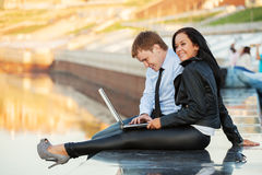 Young business couple using laptop Royalty Free Stock Images