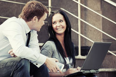 Young business couple using laptop outdoor Royalty Free Stock Photo