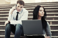 Young business couple using laptop outdoor Stock Photo