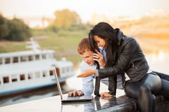 Young business couple using laptop outdoor Stock Photography