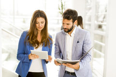 Young business couple using tablet in the office. View at young business couple using tablet in the office Stock Photo