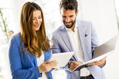 Young business couple using tablet in the office. View at young business couple using tablet in the office Royalty Free Stock Photos