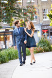 Young Business Couple Walking Through City Park Together Stock Photos