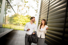 Young business couple walking outdoor near the office building Royalty Free Stock Images