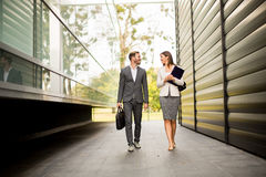 Young business couple walking outdoor. Near the office building Royalty Free Stock Photography